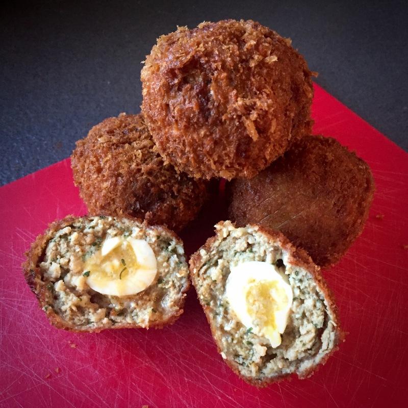 scotch quail eggs served
